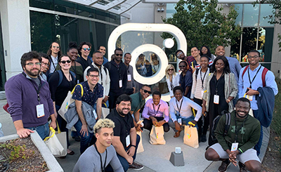A group photo of the Vivid in Research 2019 Cohort standing next to the Instagram logo