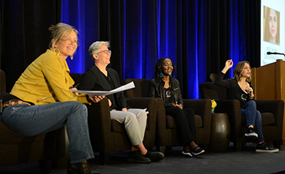 Photo of me and 3 other panelists at the Women in Data Science Conference